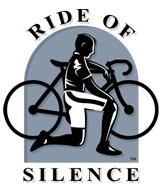 man kneeling next to bike
